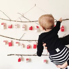 DIY Ikea Hack for your advent calendar! Head to Ikea, grab their cheap adorable little red and white advent houses... find a few branches. Viola. We filled our advent with activities to do as a family since the baby is too young for chocolate!