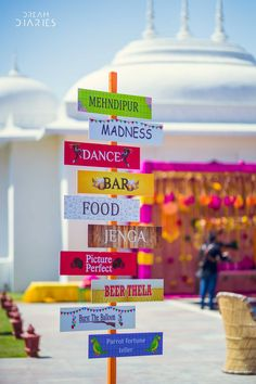 Mehendi decor inspiration | Sign boards | Mela theme mehendi function | Quirky mehendi decor | Indian wedding decor ideas | Fun mehendi ideas | Photo Credits: Dream Diaries | Every Indian bride's Fav. Wedding E-magazine to read. Here for any marriage advice you need | www.wittyvows.com shares things no one tells brides, covers real weddings, ideas, inspirations, design trends and the right vendors, candid photographers etc.