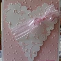 Card size: A2  Sizzix Textured Impressions: Birthday Set #2 (Three Dots background folder). SizzixBigz Die:  Scallop Heart Bigz Die. Cuttlebug Birds &Swirls Embossing Folder.  Stampendous: Flexible Friendship Wishes.  3mm pink pearls.