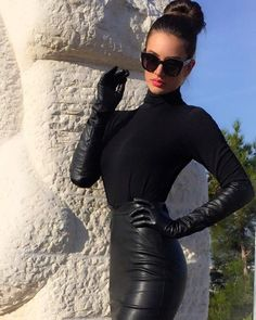 Black turtleneck paired with leather skirt and long leather gloves - PERFECT!