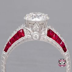 Certified Art Deco Style Engagement Ring is constructed by a master craftsmen, is mounted with French-cut Rubies and full-cut diamonds