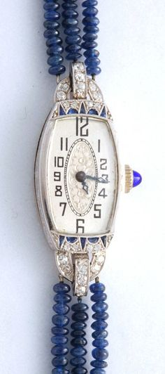 Art Deco Diamond & Sapphire Watch with Sapphire Bead Band. Exceptional Art Deco Diamond & Sapphire design with a beautiful (as well as easy to read)dial, this watch was originally given as a gift in 1924. We later added the sapphire beads and diamond spacers to showcase the head. The watch head is platinum, and the later added band is 14k white gold.