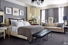 A chandelier by Williams-Sonoma Home overlooks the master bedroom in this Beaux Arts building in Kansas City, Missouri.