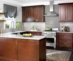 Cherry cabinets and white counters and grayish backsplash