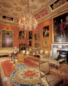 The Cinnamon Drawing Room was originally hung with white silk and was known as the White Drawing Room. In the winter of 1988-89 family portraits from around the House were brought together and hung in this room. The wall colour was changed to cinnamon to show these magnificent paintings to their full advantage. The unusual Adam ceiling and coving decoration by Alfred Stevens (1817-75) remain.