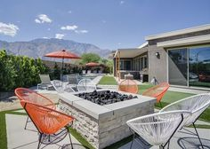 This flawless Palm Springs vacation rental house has mid-century modern style and a coveted outdoor space with pool, putting green and fire pit—all just minutes from downtown and the iconic shopping on North Palm Canyon Drive. Palm Springs Vacation Rentals, Vacation Home Rentals, Mid Century Style, Mid-century Modern, Home And Family, Fire, Patio, Building, Outdoor Decor
