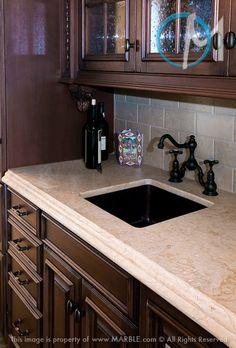 Durango granite countertop with dark cabinets and subway tile backsplash