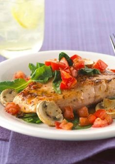 Baked Salmon with Tomatoes, Spinach & Mushrooms – Flavorful salmon is baked with spinach, mushrooms, and tomatoes and dressed with vinaigrette. This Healthy Living recipe is a tasty way to get your family eating right.