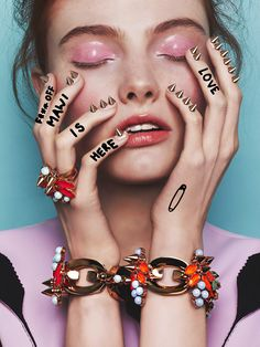 Images are defaced by etchings, slogans and graffiti creating a techno-tribal warrior, barbed with studs in her nose – a punked-up English Rose.