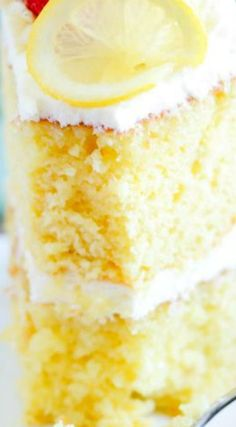 Ina's Lemon Cake ~ Rich lemon cake that tastes incredible with cream cheese frosting and raspberries!