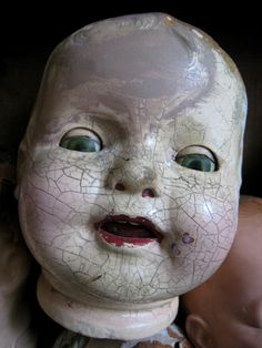 Vintage Creepy Doll Heads Statement Piecehttps://www.etsy.com/listing/111685709/various-vintage-creepy-doll-heads-wood
