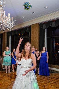 bouquet toss, bride throwing the bouquet. Wedding at Arlington Heights United Methodist and The Fort Worth Club