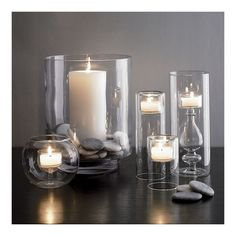 Shop Crate and Barrel for a variety of candle holders, including glass hurricanes, votive, pillar and tealight holders, sconces and more. Hurricane Candle Holders, Candle Set, Candle Stand, Silver Christmas Decorations, White Candles, Decorating Coffee Tables, Home Decor Accessories, Crate And Barrel, Chandeliers