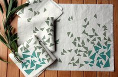 Love these. Look at block printing with paint from Dharma Trading for similar DIY napkins, tablecloth etc.