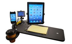 JourniDock Features: A Car Desk that Docks Electronics         A New Way To Dock Your Devices JourniDock is a docking system for your vehicle that holds your GPS device, cell phone, and iPad conveniently within arms reach. JourniDock device holders are universal by design and fasten securely to the