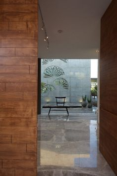 In and Out Living by S A K Designs: A house designed specifically for enjoying the nature all the time whether from inside or outside. Foyer Design, Entrance Design, Wall Design, House Design, Entrance Foyer, Glass Design, Entryway, Living Room Partition Design, Room Partition Designs