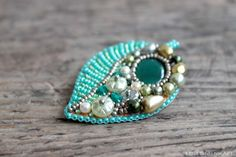Hey, I found this really awesome Etsy listing at https://www.etsy.com/listing/176411754/bead-embroidery-brooch-beadwork-green