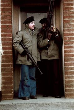 Two Provisional IRA gunmen stand in a doorway in Londonderry.  January 30th, 1978