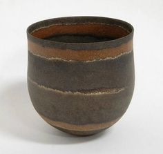 Jennifer Lee Lee's pots are hand built and she has developed a method of colouring them by mixing metallic oxides into the clay before making.