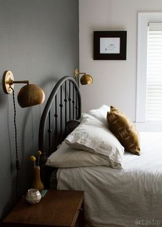 sonora pillow // skirt as top, love the dark wall and Schoolhouse Electric lamps too!
