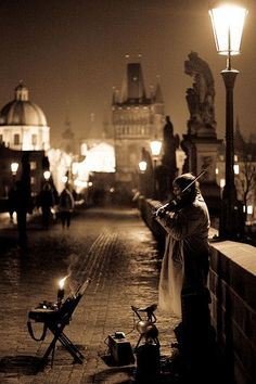 Taken during one cold winter night on Charles Bridge, Prague, Czech Republic. The Violinist . I can only imagine the beauty on a cold winter night. Charles Bridge, Pont Charles, Night Photography, Street Photography, Prague Photography, Street Musician, Prague Czech Republic, Nocturne, Photos