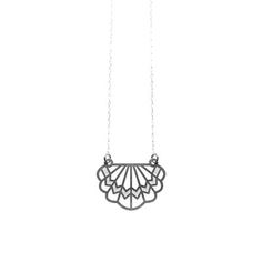 This necklace is made from finely etched stainless steel and connected to a sterling silver chain. Inspired by the geometric patterns in art deco design and architecture.