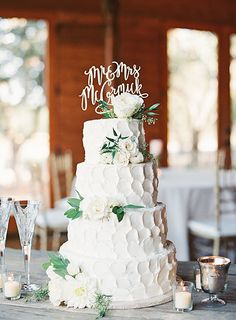 White Wedding Cake Decorated with Bride and groom's Names | Brides.com
