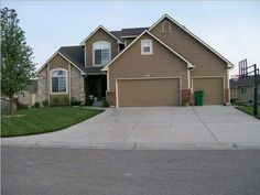 WICHITA Home For Sale, 806 N WHITE TAIL CT, WICHITA, KANSAS - J. P. Weigand  Sons, Inc. - Listing # 364026 ~ This IMMACULATE home has 5 bedrooms, 3.5 baths, oak hardwoods, a custom epoxy garage floor, split bedroom plan, main floor laundry, a covered deck, vaulted ceilings, a home theatre, and SO MUCH MORE!!! Pride in ownership shows in every room and in every corner of this sweet home. Call/text 316-655-3631 or email jodig@weigand.com for a showing! :)