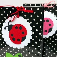 Lady Bug gift tags. Baby shower first birthday party theme. Red or Pink, black spotty favor bags.