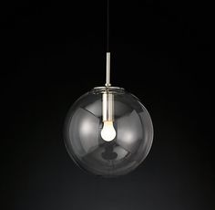 RH's Languedoc Pendant:The character of 1960s French lighting is captured in this pendant from renowned designer Jonathan Browning. With glass globes suspended from a slender brass frame, the fixture has the appearance of floating in space.