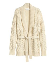 Long-sleeved, cable-knit cardigan in a creamy white wool blend with a shawl collar. Tie belt at waist. | Warm in H&M