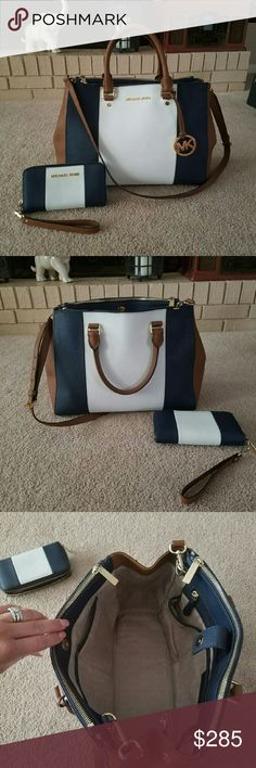 Michael Kors Sutton Set Authentic MK Sutton Saffiano Center stripe/Colorblock large w/ matching zippy tech wallet/wristlet. Colors R Navy,luggage & white.Both in Excellent used condition.only flaw on purse is zipper pulls have tiny spots at base where gold has rubbed off a bit but its not noticeable at all unless inspecting. Will come with dustbag upon request. Will only trade for like val item.only210 on M! Michael Kors Bags Satchels