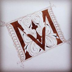 "Illuminated letter ""m"""
