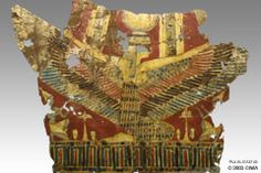 This is one of the cartonnage trappings of the mummy of Great Royal Princess Baket, daughter of Thutmose III, Dynasty 18. This piece, which once laid on the chest of the mummy of the princess, depicts Goddess Isis wrapping her protective arms/wings over the defunct. A thin gold band highlights her headdress, capped by the solar disk and the cow horns, attributes of Isis. On both sides beneath her wings, offering tables are presented by the king wearing the crown of upper Egypt.