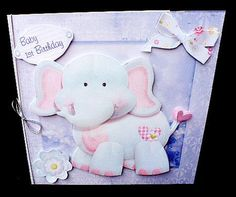 baby elephant mini kit on Craftsuprint designed by Cynthia Berridge - made by Diane Hitchcox - I printed out onto 240 gram card and mounted on a card using dst, decoupaged with sticky pads and attached a silver elasticated bow down spine. - Now available for download!