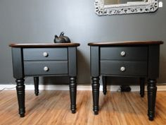 These two end tables were painted black with the tops stained in a dark brown with black plaid knobs.