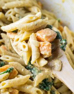 Creamy one pot sweet potato and spinach pasta made with fresh garlic and onion, vegetable broth, barilla penne, and a homemade cream sauce.