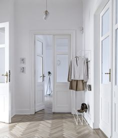 Minimal white hallway with parquet floor