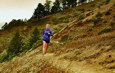 woman running through fields