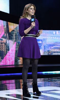 Princess Beatrice wore velvet footwear and a purple minidress on stage at WE Day New York Welcome, to celebrate young people changing the world, at Radio City Music Hall.