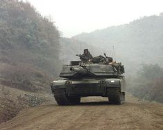 The first M1A1 (Abrams Main Battle Tank) arrives at the Twin Bridges training area in the Republic of Korea Nov. 2, 1998. The M1A1 comes from the Task Force 1st Battalion 23rd Infantry Division out of Ft. Lewis, Wash. TF 123 is conducting an assault on two Infantry companies from a Republic of Korea armored brigade in participation of Foal Eagle '98. A combined exercise involving the Republic of Korea Army and the United States Armed Forces. (U.S. Army photo by SPC Christina Ann Horne) (R...