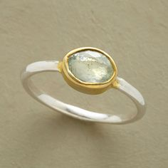 AFTER RAIN RING -- A halo of 18kt vermeil encircles clearest aquamarine, set on a simple, sterling silver band. Exclusive. Whole and half sizes 5 to 9.