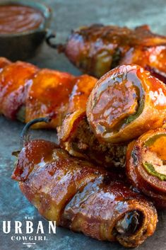 These Texas Twinkies are the newest craze in the Texas barbecue world! Large jalapeno peppers are split, stuffed with cream cheese and smoked brisket, and wrapped in bacon before being smoked to perfection. Glaze them with your favorite barbecue sauce (or a sugar-free barbecue sauce for a low-carb snack) and impress your friends and family at your next backyard barbecue, potluck, or the big game! This is a favorite tailgating and party appetizer recipe that everyone is sure to love! Tailgating Recipes, Tailgate Food, Barbecue Recipes, Grilling Recipes, Barbecue Sauce, Bacon Appetizers, Appetizer Recipes, Snack Recipes, Game Recipes