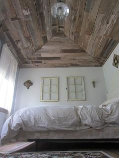 This little backyard cottage was built and decorated by Stjepan and Robin Boban. Stjepan is a carpenter by trade and used a wealth of discarded cedar fence boards and barn wood to not only clad the outside of his little cabin, but the INSIDE ceiling as well, which lends it a lot of character to this cozy place!