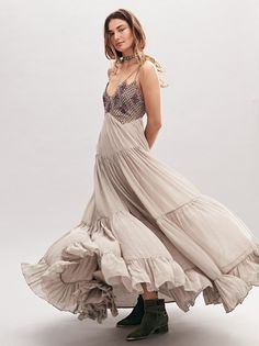 Lost In A Dream Maxi Dress | Sure to be a crowd pleaser, this beautiful and ethereal maxi dress features a statement bodice with embroidery and bead detailing. Chiffon style with a pleated and tiered skirt. Delicate strappy back with an elastic band for an easy fit. Hidden side zip closure. Lined.