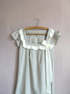 Smocking, pleats, a bow oh my!