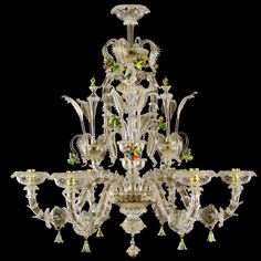 #Rezzonico #glass #chandelier, 6 lights. Crystal color body with gold details. #Hardpaste flowers.