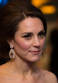 Kate Middleton Photos Photos - Britain's Catherine, Duchess of Cambridge meets BAFTA representatives as she arrives to attend the BAFTA British Academy Film Awards at the Royal Albert Hall in London on February 12, 2017...The British Academy of Film and Television Arts supports, develops and promotes the art forms of the moving image by identifying and rewarding excellence, inspiring practitioners and benefiting the public. / AFP / POOL / Daniel LEAL-OLIVAS - EE British Academy Film Awards…