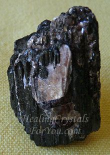 Black Tourmaline With Mica Black Tourmaline simply changes negative energy to positive energy,but if it also contains mica, it will send bad feelings back to the person who sent it, allowing the sender to realize what has occurred.