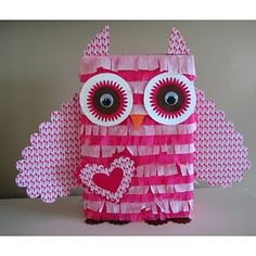 Valentine box - I made this last week with my 3rd grader and it is super cute.  We used 2 sheets of tissue paper, a walmart fruit snacks box and tape.  Easy Peasy.  (It did take a couple of hours.)
